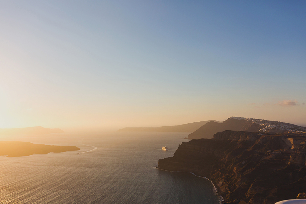 Sunset in Santorini and view to volcano