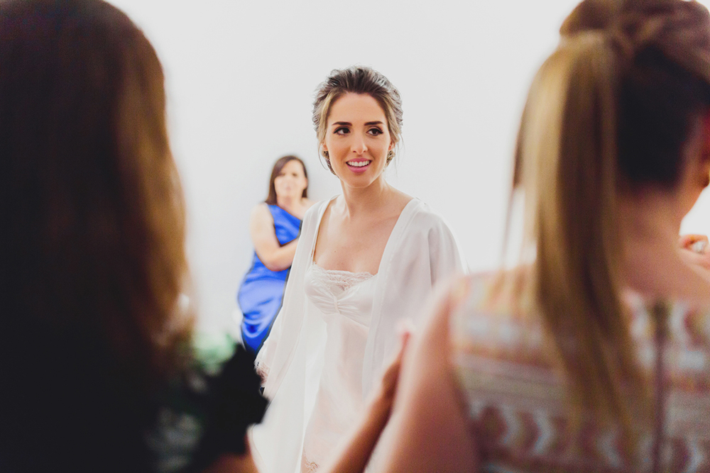 Santorini bride preparation with guests, family and friends