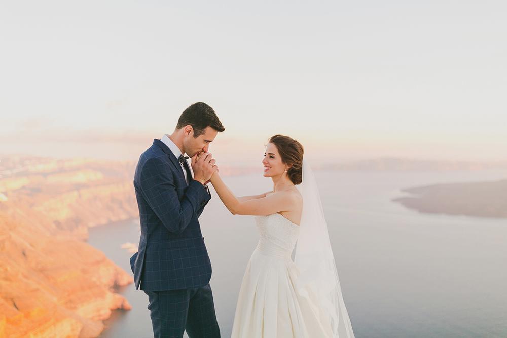 Santorini Imerovigli wedding photoshoot of bride and groom in happy love moments
