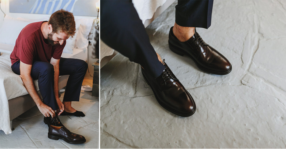 Grooms preparation, wearing his shoes