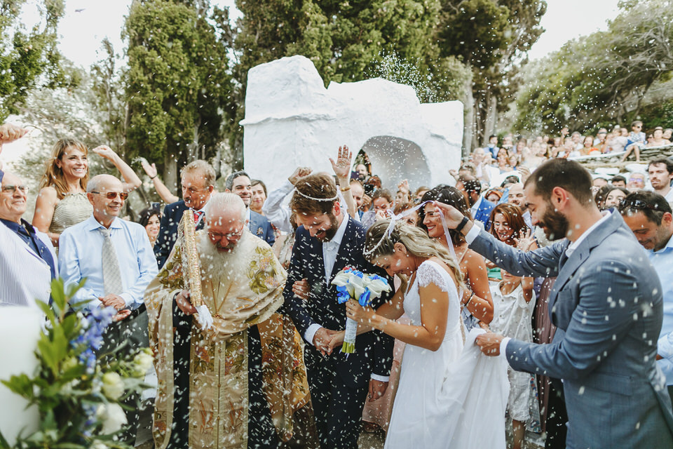 Friend and Family throwing rise on bride and groom