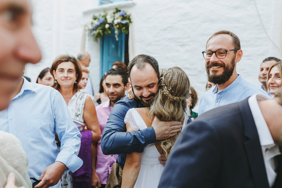 Emotional moments of the bride and the groom with their friends and family after the ceremony
