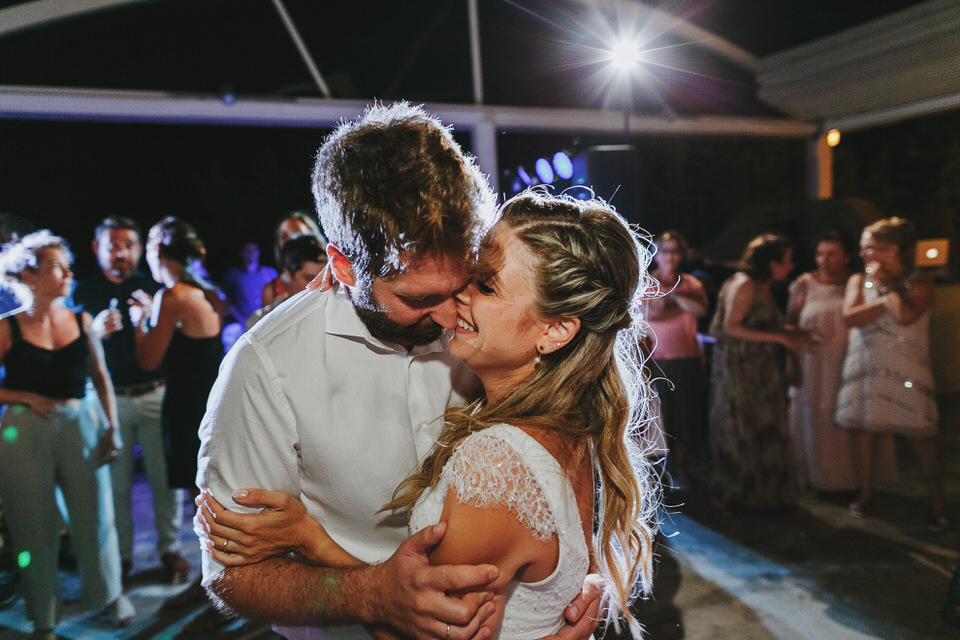 Bride and groom strong emotional, happy moment at the party
